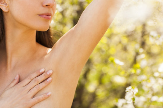 Close up of female armpit on the beautiful natural background.
