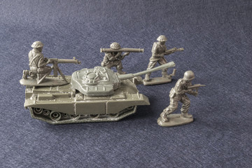 Miniature toy model team soldiers with tank