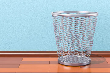 Empty metal garbage bin on the wooden floor, 3D rendering