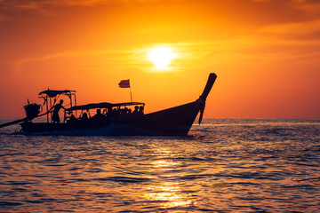 Fishing boat with sunset in phi phi islands,Thailand