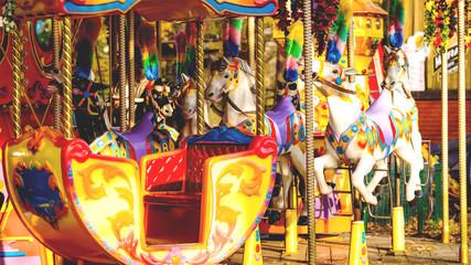 Foto op Aluminium Amusementspark horses on a carousel in an amusement park, toned