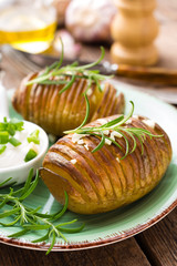 Baked potato. Potato oven baked with garlic and rosemary