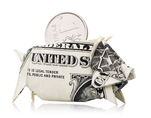 Russian ruble peeking out of piggy bank made from American dollar, isolated on white background