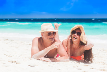 portrait of couple lying on a tropical beach, Maldives