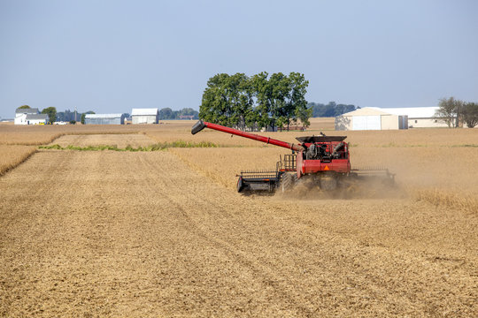 Combine harvesting soybeans in a farm field in Central Illinois