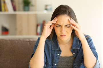 Woman complaining suffering migraine at home