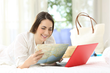 Happy hotel guest planning vacations with a guide
