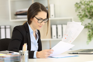 Office worker checking paper documents