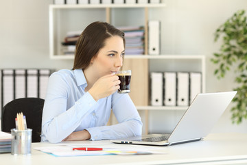 Relaxed office worker having a coffee break