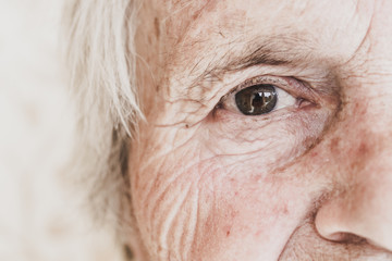 Close-up image of old woman's eye, looking at camera