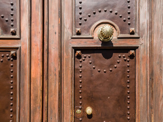 wooden door with studs of an old house