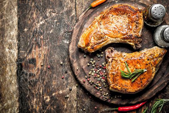 Grilled pork on a cutting Board.