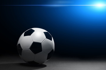 Soccer ball on the black background