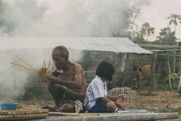 Old man and girl in countryside.