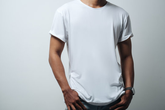 man in white blank t-shirt, empty wall, studio  casual style