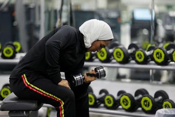 Saudi Rehab Al Mahasnha works out at a local gym in Qatif, Saudi Arabia