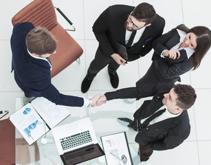 reliable handshake business partners after the discussion of the financial contract in the office