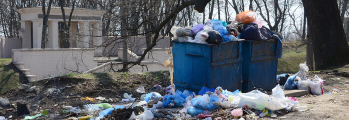 The garbage can is packed with garbage and waste. Untimely removal of garbage in populated areas