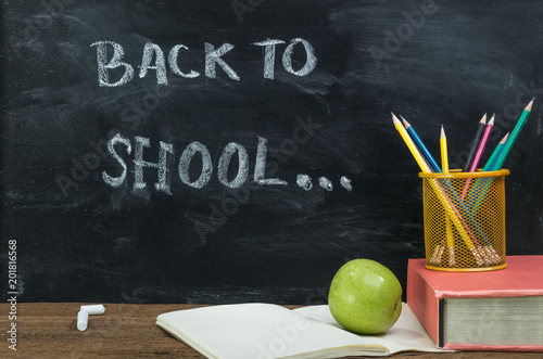 Back To School Conceptbooks Pencils And Green Apple Over Chalkboard Background Book
