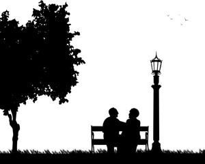 Lovely retired elderly couple sitting on bench in park or garden, one in the series of similar images silhouette