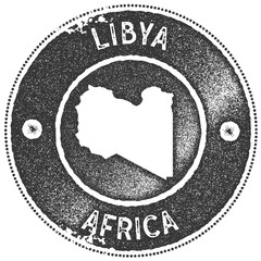 Libya map vintage stamp. Retro style handmade label, badge or element for travel souvenirs. Dark grey rubber stamp with country map silhouette. Vector illustration.