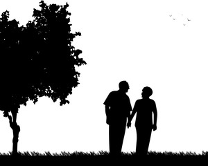 Lovely retired elderly couple walking in the park, one in the series of similar images silhouette