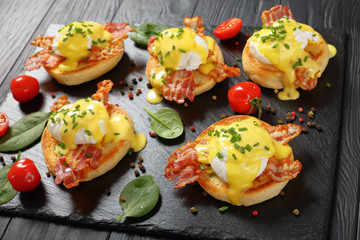 close-up of Eggs Benedict on stone plate