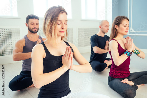 A Happy Group Of People From Men And Women Practicing Yoga In The Studio Groups