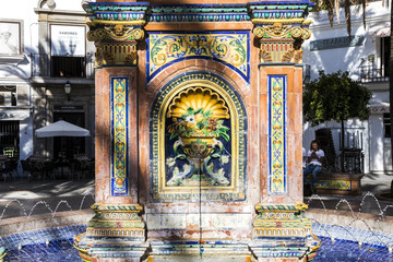 Vejer de la Frontera, Spain. Views of the Plaza de Espana (Spain Square) with the famous fountain decorated with bricks and painted tiles (azulejos)