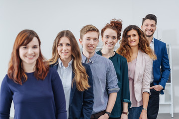 Group portrait of smiling people at office