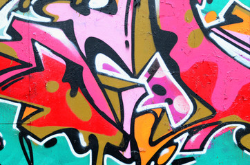 Fragment of a beautiful graffiti pattern in pink and green with a black outline. Street art...