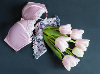 Gentle pink tulips and beautiful woman bra.  Underwear sales concept