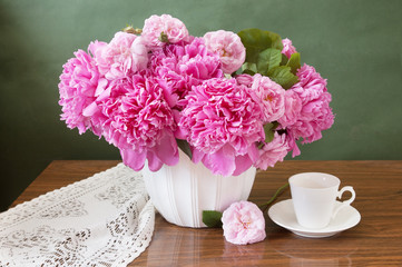 still life with peony and roses bunch and cup