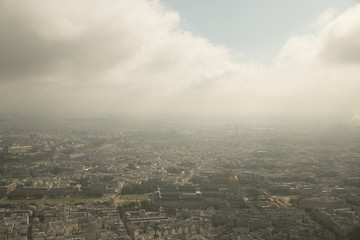 aerial view over paris with clouds sunny day