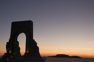 arch in marseilles at sunset