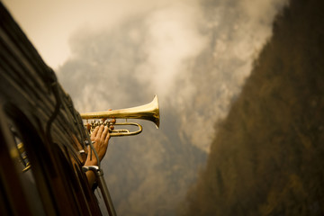 famous trumpet play with the koenigssee echo on a ferry in the middle of the lake in bavaria
