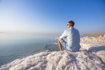 Ttourist on shore of Dead Dea. Jordan landscape
