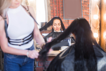 Picture showing hairdresser holding scissors and comb