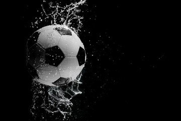 Soccer ball on the black background.