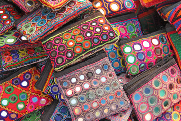 Purse cosmetic purses are bright and colorful with mirror inserts sold on the market in India. Gift souvenir India Tibet Bazaar