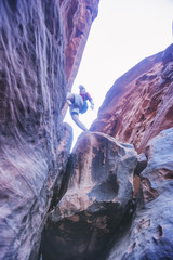 Tourist on the rocks, canyon of Khazali. Wadi Rum Desert, Jordan