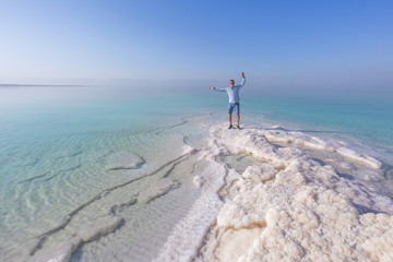 Tourist on the shore of the Dead Sea. Jordan landscape