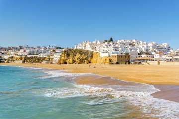 Wide, sandy beach in white city of Albufeira, Algarve, Portugal