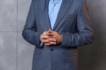 man in suit shows gestures with his hands