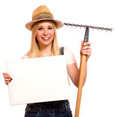 Gärtnerin mit Schild