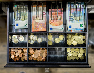 Cash and coins in till