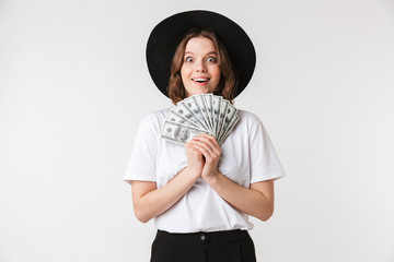 Portrait of a satisfied young woman dressed in black hat