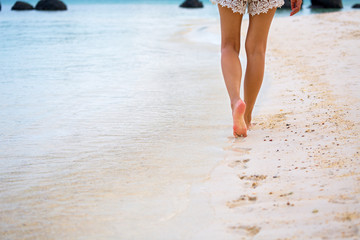 Travel woman foot on beach