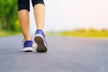 Woman feet running on road, Healthy fitness woman training