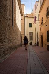 Tourist woman walking on street